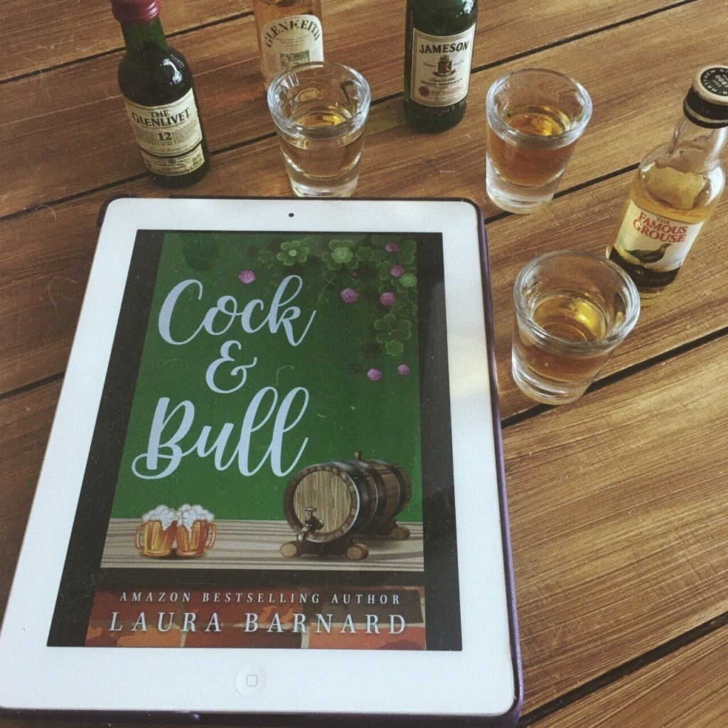 The image shows the ebook cover of Cock & Bull by Laura Barnard together with some shots of drinks like Jameson and Famous Grouse.